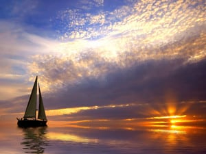 Bareboat sailing at sunrise