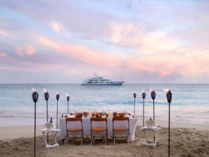 Dinner at the beach overlooking the yacht in Greece