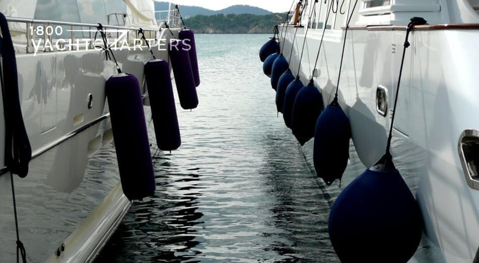 nautical terms - photograph of fenders, protection, hanging on the side of yachts that protects the boats from hitting against each other