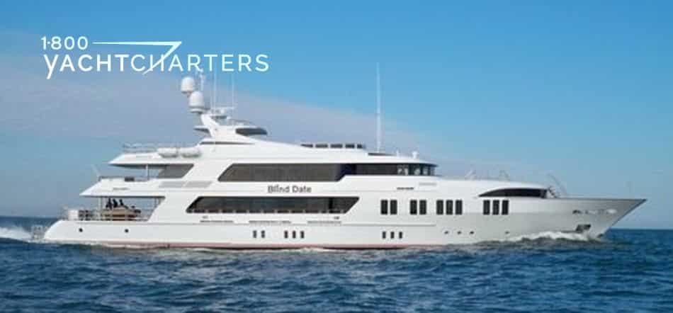 Blind Date motoryacht. Photograph from the side. Yacht is facing the right side of the picture. Solid white yacht.