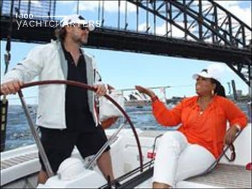 Oprah Winfrey and Russell Crowe photograph, laughing on a sailboat