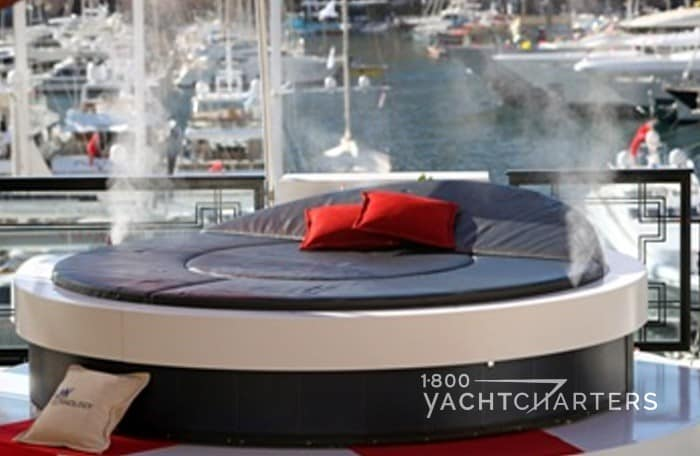 rotating yacht sun bed with misters spritzing water