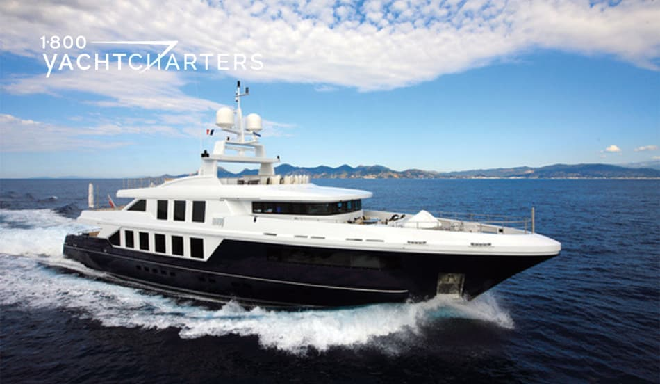 Natori yacht photo. Boat is underway, headed to the right of your screen. Hull is black. Superstructure is white.