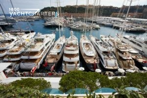 Cannes film festival. Yachts at dock. All yachts docked with back of yacht at dock. Photo is taken from above the marina.