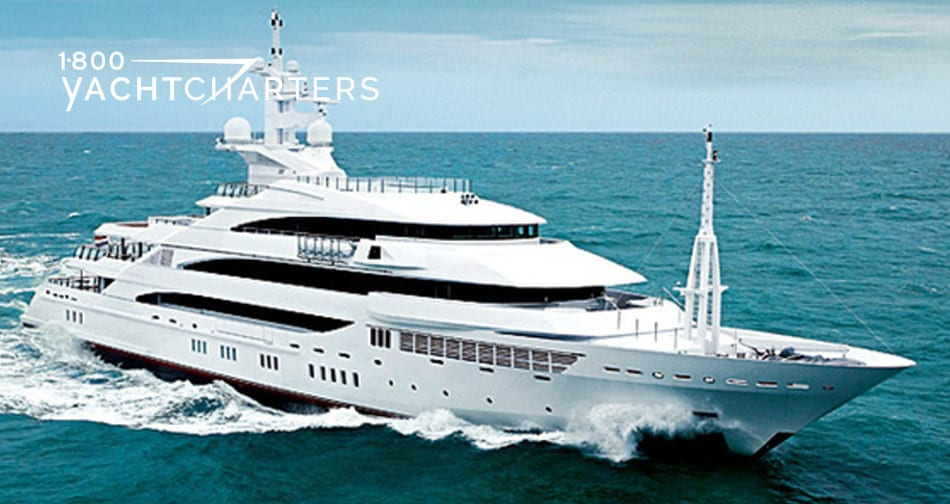 Amevi superyacht photograph.  Solid white yacht is underway. Heading toward lower center of right side of photo. Waves are lapping at bow and sides of boat.