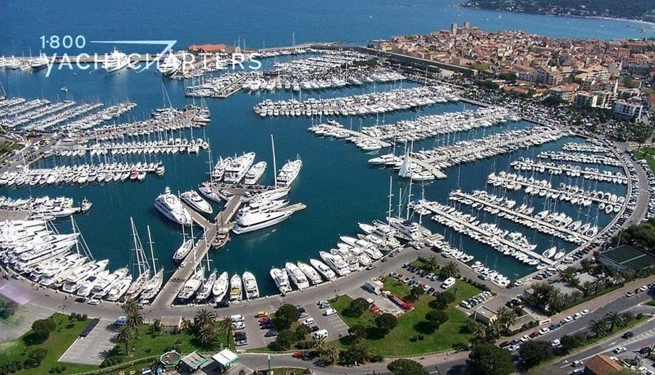 Aerial photograph of a superyacht marina.