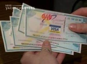 Travelers check photo. Picture of female hands holding a stack of travelers checks.  They are VISA travelers checks with visa logo in the center