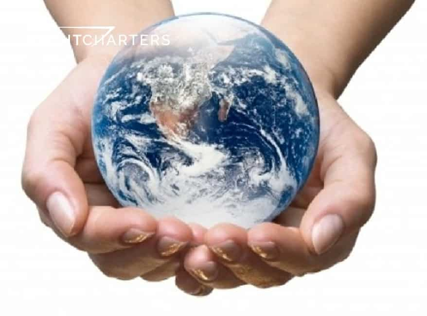 Save the Earth. Cupped hands holding a blue, white, and orange round globe of the planet.