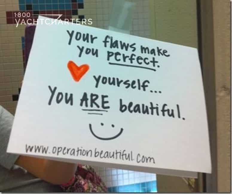 "Photograph of a post-t note on the mirror of a women's bathroom.  The post-it note reads ""your flaws make you perfect. <3 yourself...you ARE beautiful"" with a smiley face."