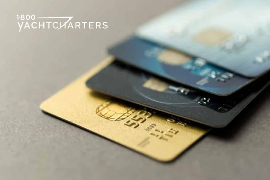 stack-of-credit-cards-amex-centurion-black-card-1800yachtcharters