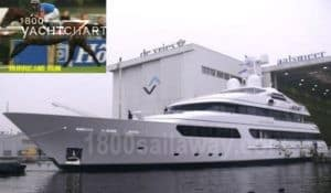 Photograph of the yacht, Hurricane Run, coming out of the shipyard. At the dock, facing the left side of the photo. In the top left corner of the photo is a tiny photo of a racehorse named Hurricane Run