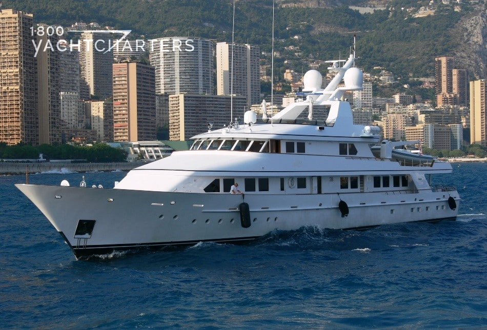 Profile photo of motoryacht Jana underway. The city of Monaco is in the background.