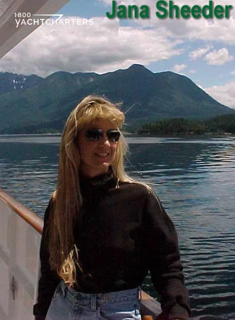 Photograph of Jana Sheeder, President of 1-800 Yacht Charters and SailAway Yacht Charter Consultants.  She is leaning on the side rail of a motoryacht.  Her name is written in green at the top of the photo.