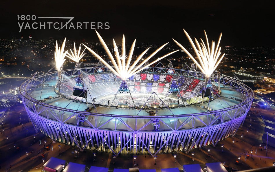 Photograph of the China Olympics Stadium - Birds Nest - with fireworks shooting off from within the stadium