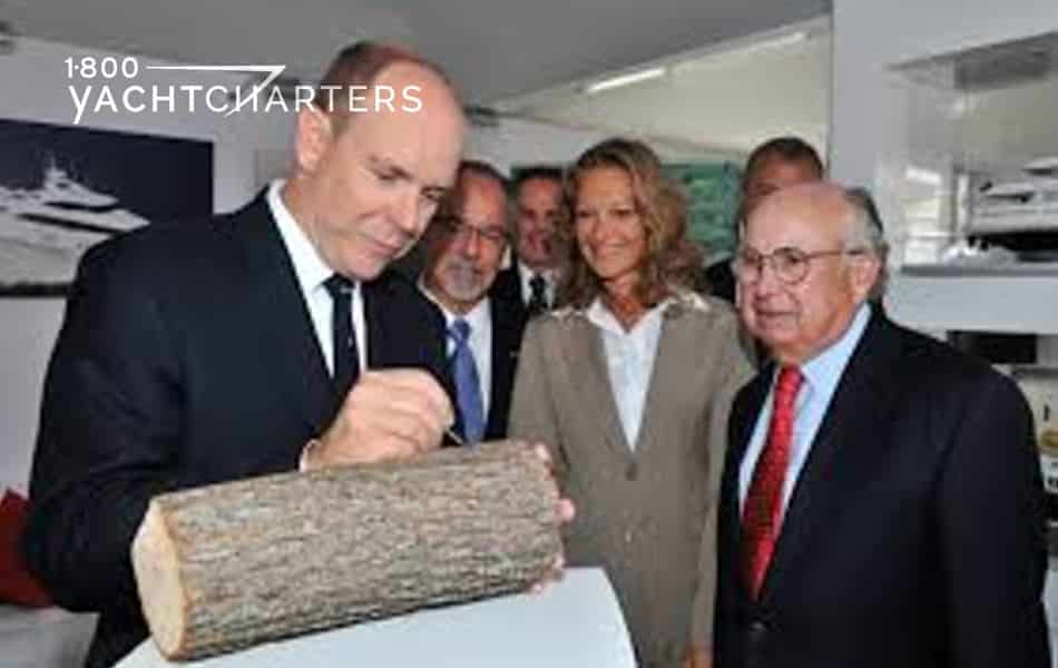 Prince Albert 2 of Monaco signing the Wood Forever pact in a room of people. Photo includes the Prince in front left side of photo, then others surrounding him.