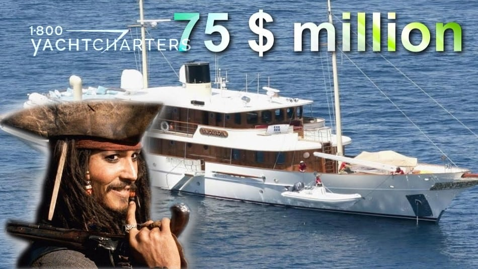 Photograph of brown and white old-fashioned motoryacht owned by Johnny Depp. Depp headshot with him dressed as a pirate is superimposed into the lower left corner of the photo. He is smiling and holding an old-fashioned pistol up by his chin. The words, 75 $ million, are written over the top of the photos.