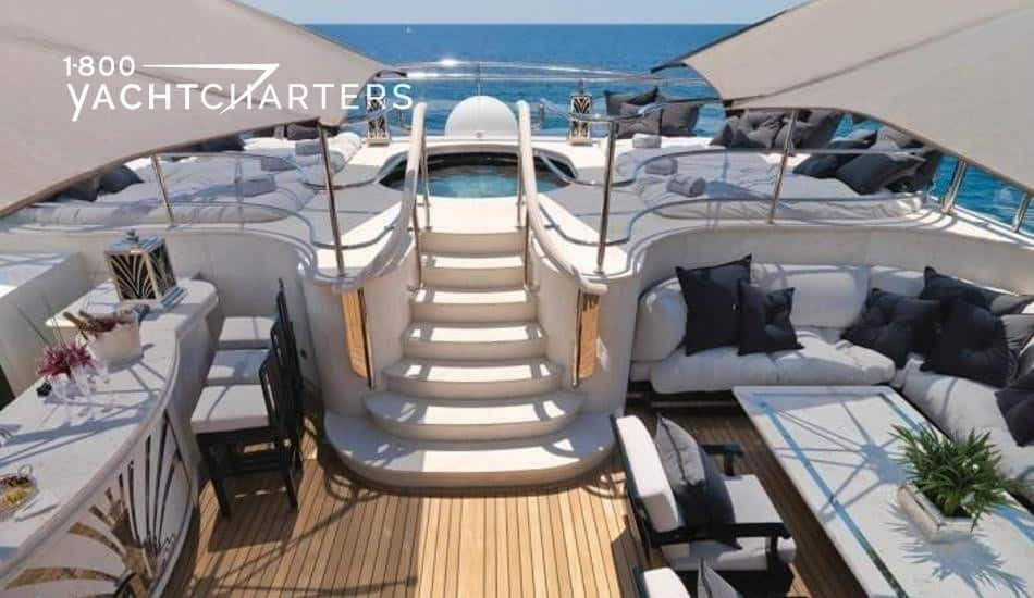 Photograph of the deck of motoryacht Silver Angel.  The photo shows a staircase leading up to the hot tub on deck.
