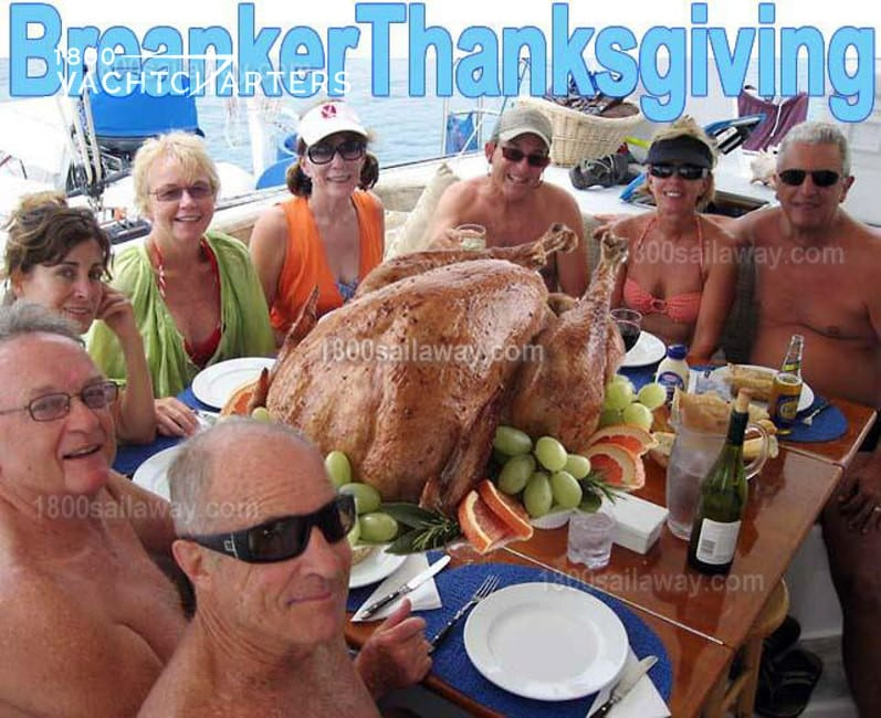 Photograph of people in swim attire gathered around a dining table to celebrate Thanksgiving dinner. Top of photo reads, Breaker Thanksgiving