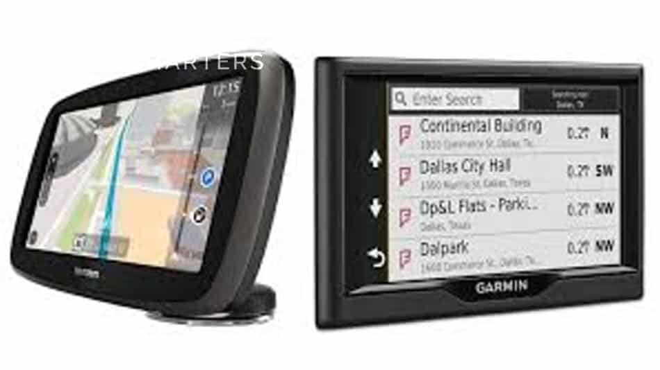 Photograph of a TomTom GPS system next to a Garmin GPS system. They are both sitting up so that you can compare the screens and features.