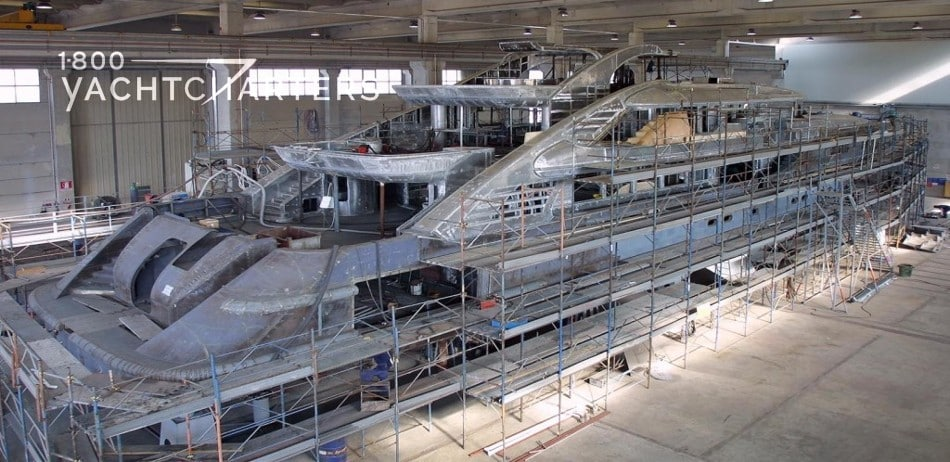 Photograph of a yacht under construction.
