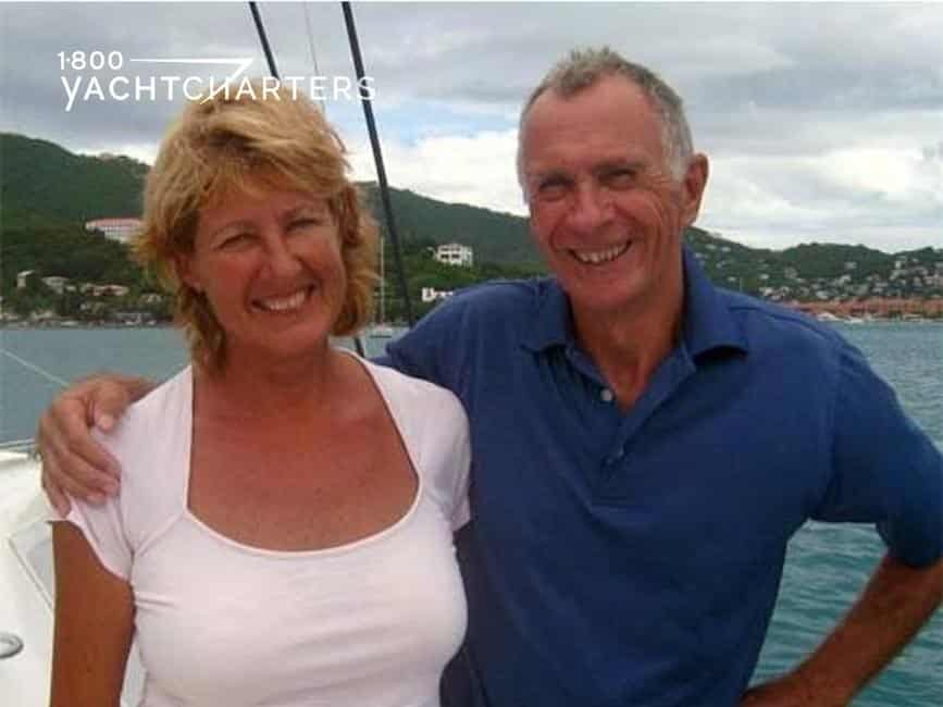 Photograph of Iza and Geoff, the crew of catamaran Dreaming On.
