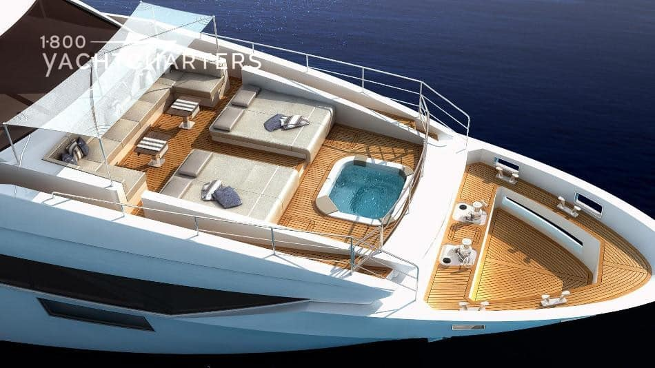 Aerial photograph of a yacht with a hot tub at the front.