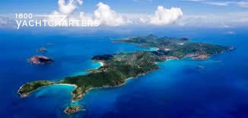 Aerial photograph of the island of St. Barths in the Caribbean. Large island surrounded by blue water.