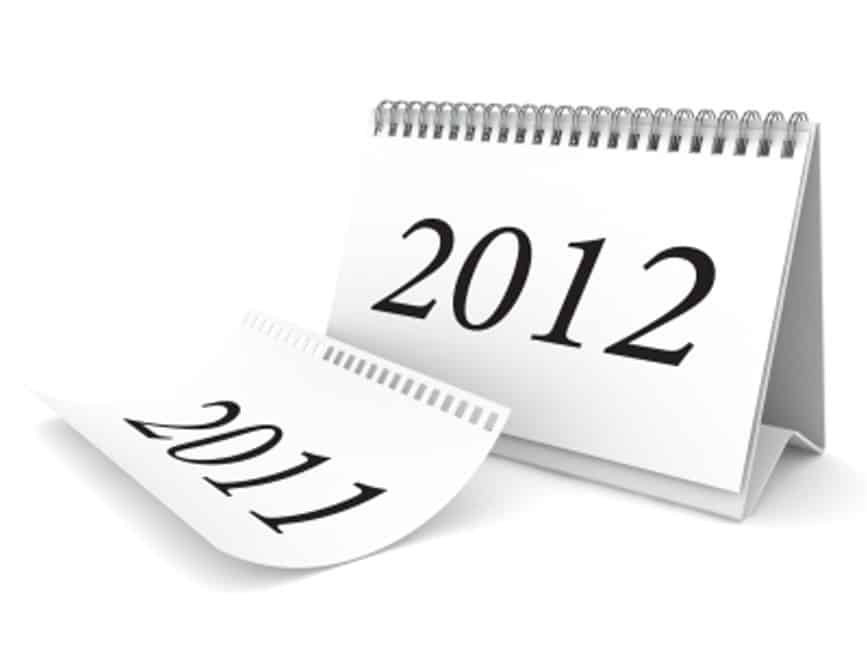 Photograph of two calendars showing the year number only. One says 2011, and the other says 2012.  They are white spiral bound, with black font.