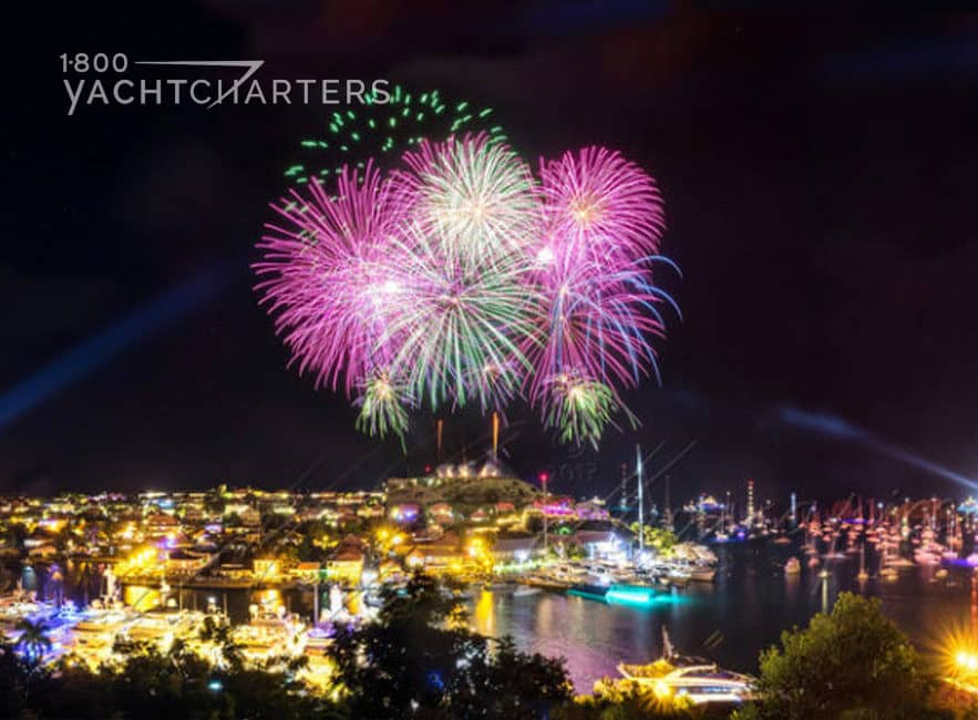 Photograph of fireworks over Gustavia, St. Barts. There are hundreds of yachts in the harbor below the fireworks show.