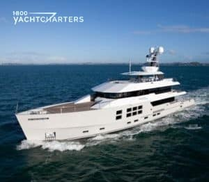 Photograph of motoryacht BIG FISH underway, heading left and down to corner of photo