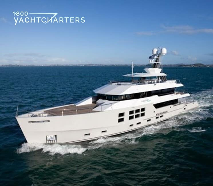 Photograph of motoryacht BIG FISH underway. She is coming toward the lower left side of the photo