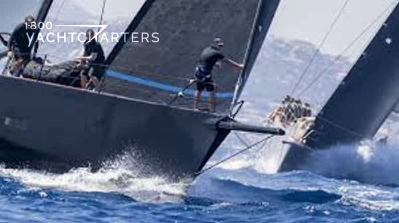 Photograph of 2 large sailboats with black hulls and black sails racing. They are both close-up photos of the yachts side-by-side.