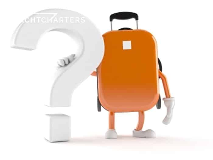 Photo of a white question mark being held up by a suitcase with arms. Looks realistic. 3D animation that isn't moving, maybe?