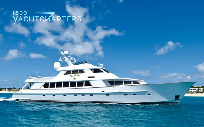 Profile photograph of solid white motoryacht, EL JEFE. She is facing the right side of the photo.