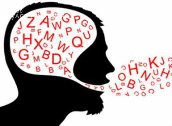 Black silhouette drawing of a man with bearded chin. He is facing the right side of the screen. His head is white, and it is filled with red letters, all jumbled. He is speaking, and letters are coming out of his mouth in jumbled form. They are funneling from his brain down to his mouth and out of it.