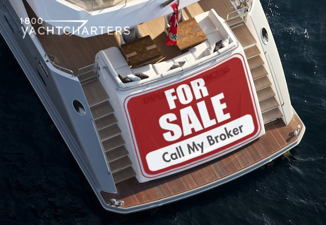 "Aerial photograph of the back of a motoryacht. There is a ""For Sale"" sign on the back of the boat. Under the words, For Sale, it reads, Call My Broker. The sign is red with white letters. The words, call my broker, are in black."