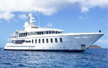 Profile photograph of Feadship motoraycht HARLE.  She is at anchor. She is facing the right side of the photo.  She is a big white boat with lots of windows.