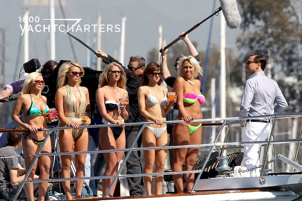 Photo of Leonardo DiCaprio on the deck of a yacht with 5 bikini-clad young women on deck with him
