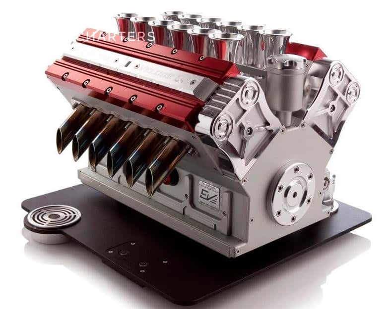 Photograph of the Espresso Veloce coffee maker. It looks like a red and silver race car engine.