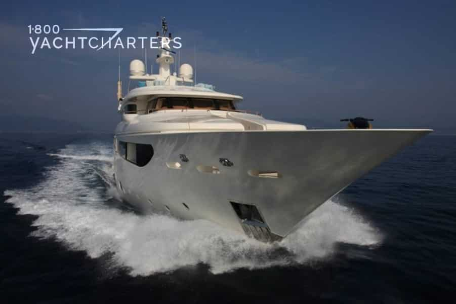 Photograph of motoryacht HANA underway. Photo taken from quarter bow profile, so you see the massive and sharp nose of the boat