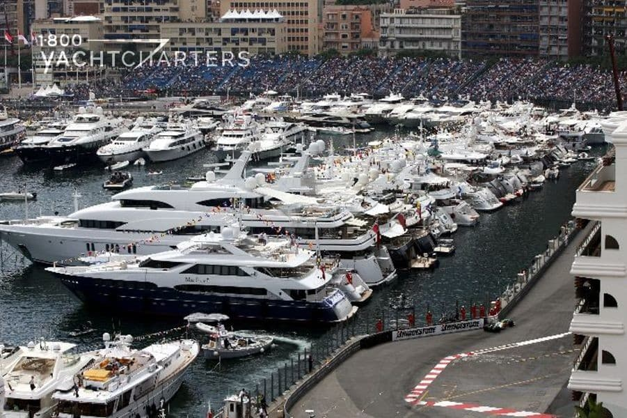 Yachts docked in the marina next to the Monaco Grand Prix racetrack. At least 100 yachts in the photo
