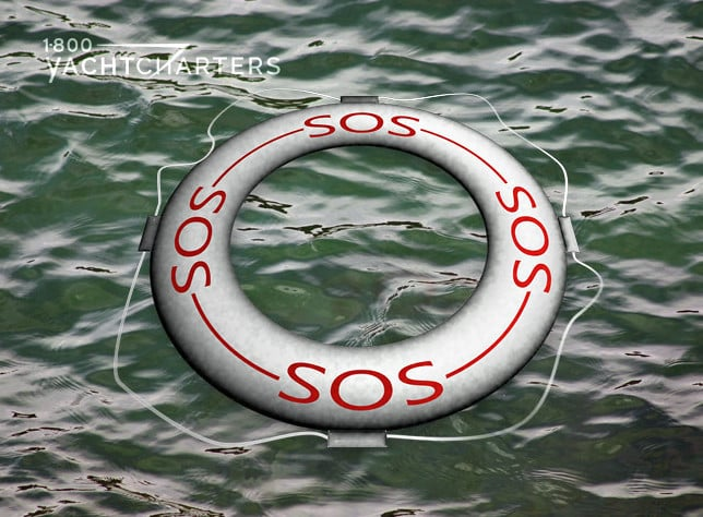 A white lifering floating on olive green water. The ring is white, and the words, SOS, are written on it, in red, 4 times. It is floating with the lettering up.