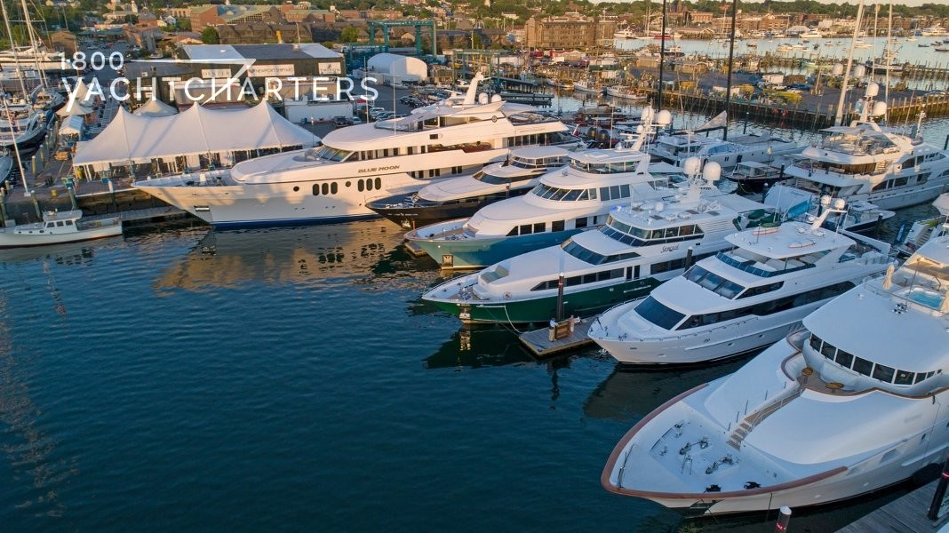 Aerial photo of numerous superyachts in a marina