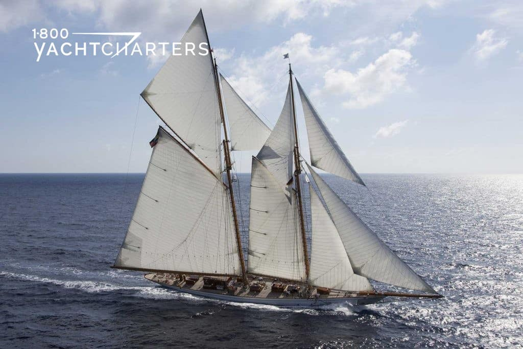 Profile photograph of classic sailboat, Germania Nova, underway