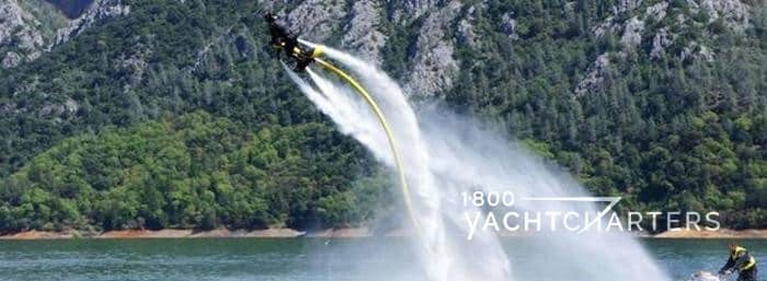 person in air on jetovator watersports toy