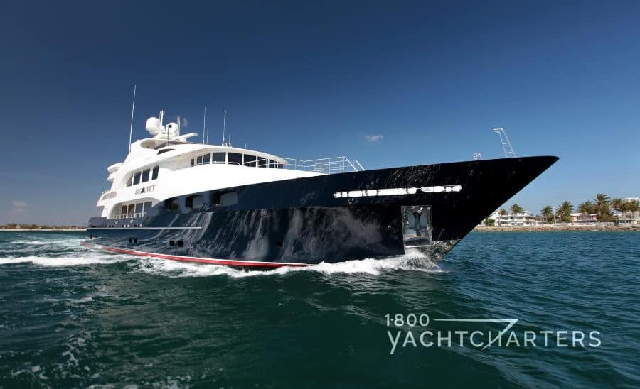 WAKU yacht with blue hull and white superstructure 1800yachtcharters