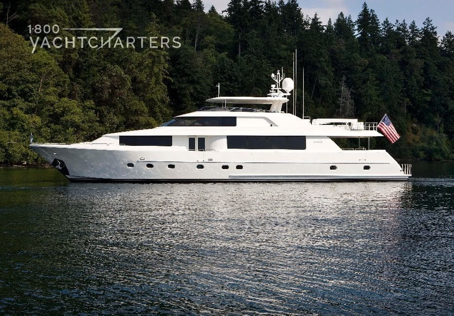 At anchor in a cove surrounded by evergreen trees
