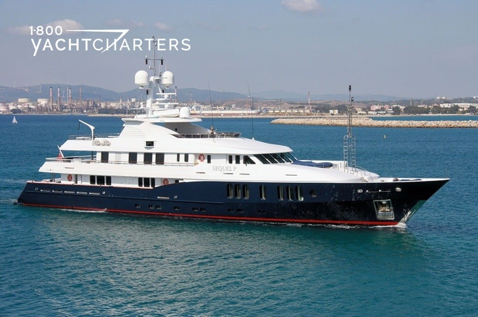 Profile photograph of a power superyacht. She has a black hull and white superstructure.