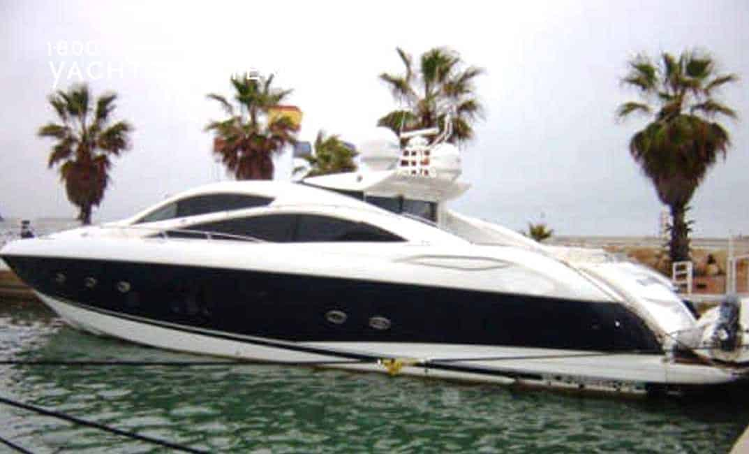 At dock - white powerboat with thick black horizontal stripe across side