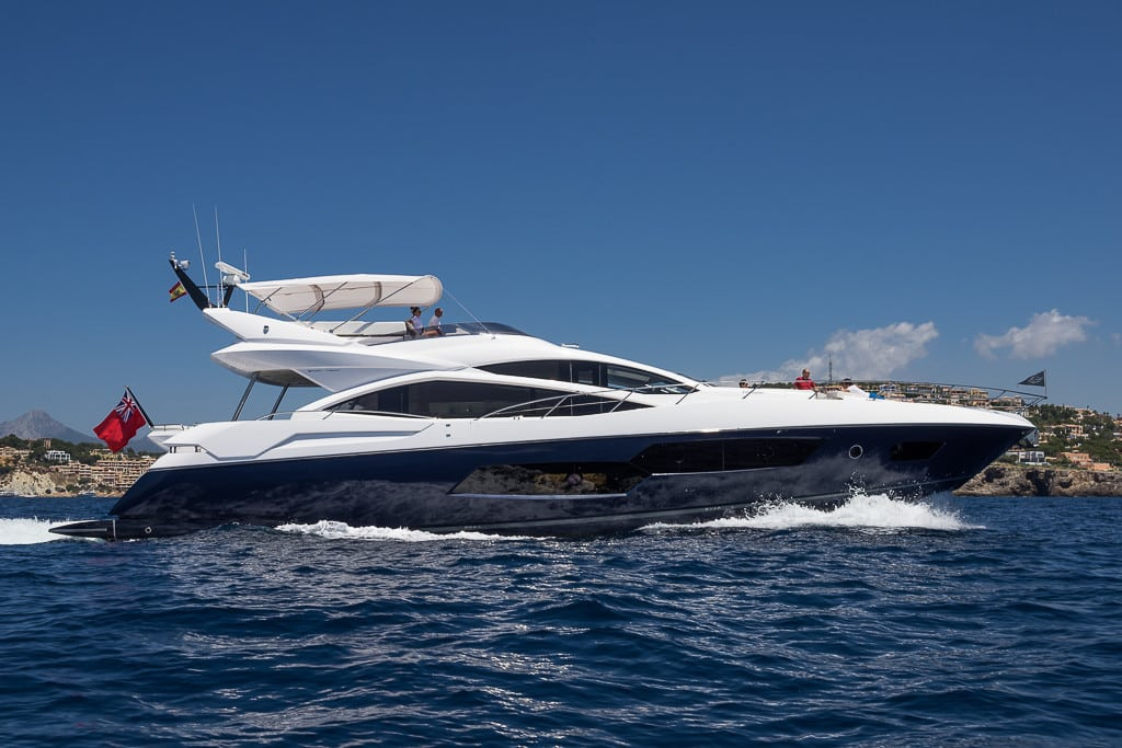 Seawater Sunseeker motoryacht with blue hull running to the right